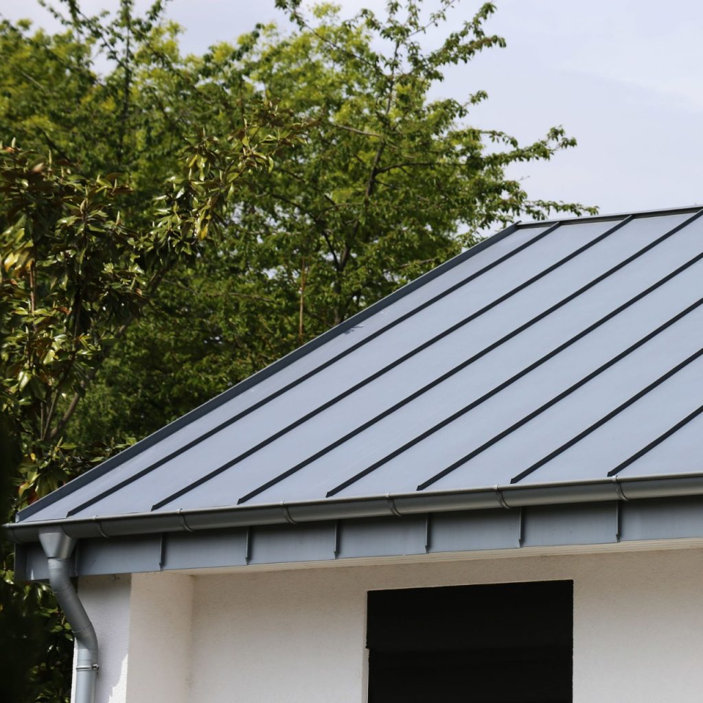 standing seam metal roof on white building